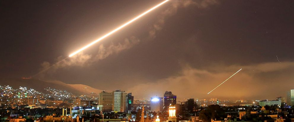 FILE - In this early Saturday, April 14, 2018 file photo, Damascus skies erupt with surface to air missile fire as the U.S. launches an attack on Syria targeting different parts of the Syrian capital Damascus, Syria. A spokesman for the U.S.-led coal