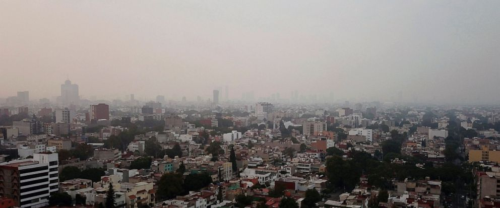 Smoke covers Mexico City, Sunday, May 12, 2019. Mexico City has warned residents to remain indoors as forest and brush fires carpet the metropolis in smoke. (AP Photo/Christian Palma)