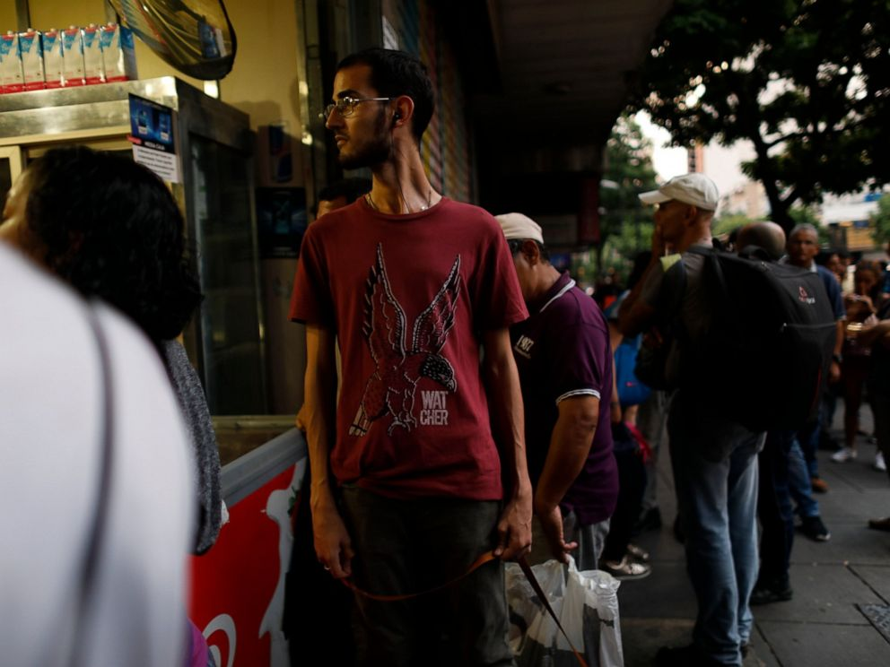 People walk in the streets of Caracas after a massive blackout left the city and other parts of the country without electricity, in Caracas Venezuela, Monday, July 22, 2019. The power in the capital went out around 4:30 p.m. (2030 GMT) and immediatel