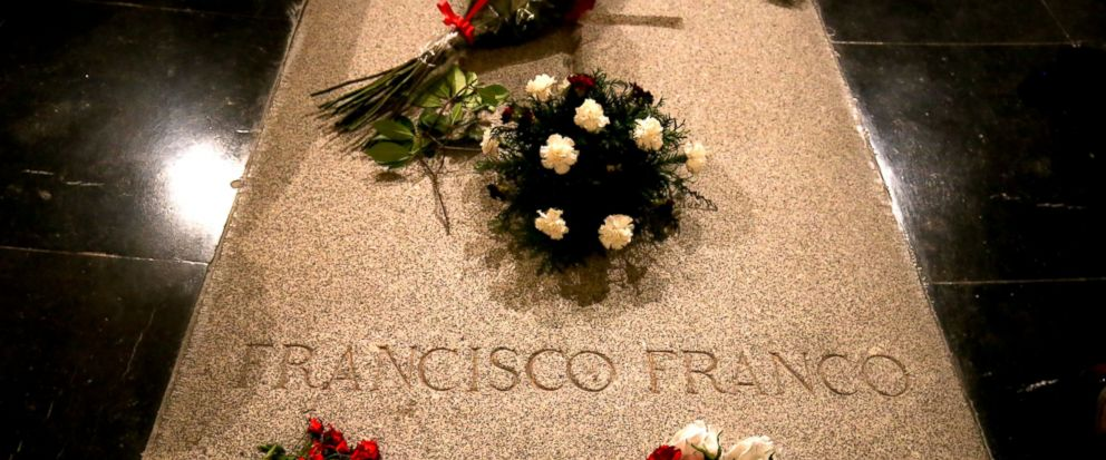 FILE - In this Friday, Aug. 24, 2018 file photo, flowers are placed on the tomb of former Spanish dictator Francisco Franco inside the basilica at the the Valley of the Fallen monument near El Escorial, outside Madrid. Spain's Socialist government ha