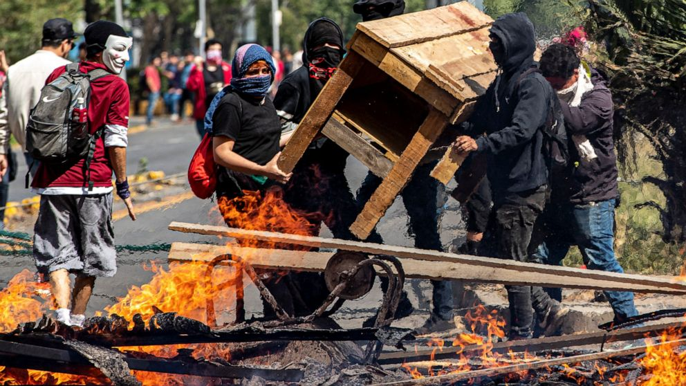 Soldiers patrol Chilean capital after violent protests thumbnail