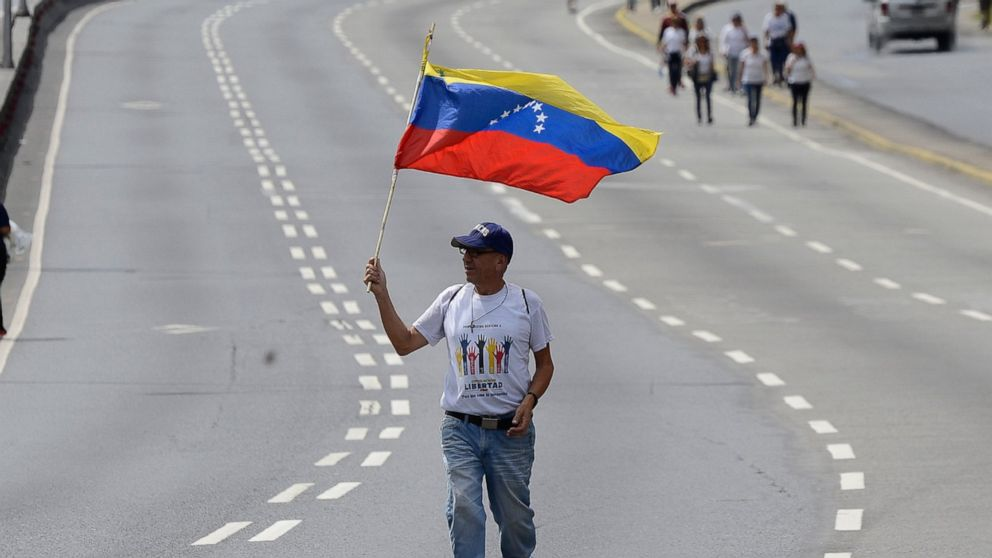 Crowds gather in Venezuelan's capital for rival protests