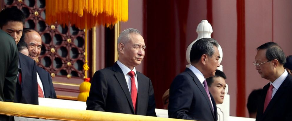 In this Oct. 1, 2019, photo, Chinese Vice Premier Liu He, center, stands on Tiananmen Gate near Tiananmen Square with other leaders before a parade to commemorate the 70th anniversary of the founding of Communist China. Liu will lead a delegation tha