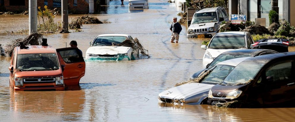 Vehicles are seen in mud water as Typhoon Hagibis hit the city in Sano, Tochigi prefecture, Sunday, Oct. 13, 2019. Rescue efforts for people stranded in flooded areas are in full force after a powerful typhoon dashed heavy rainfall and winds through