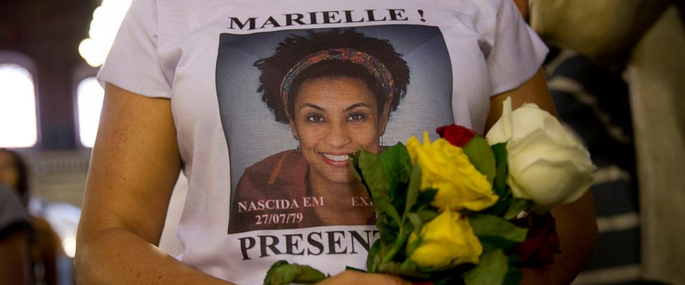 FILE - In this March 14, 2019 file photo, a woman wears a T-shirt designed with an image of slain councilwoman Marielle Franco during a memorial Mass to mark the one-year anniversary of her death, at the Candelaria Catholic Church in Rio de Janeiro,