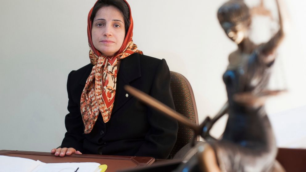 In this Nov. 1, 2008 photo, Iranian human rights lawyer Nasrin Sotoudeh, poses for a photograph in her office in Tehran, Iran. On Wednesday, March 6, 2019, the New York-based Center for Human Rights in Iran, said Sotoudeh, a prominent human rights lawyer in Iran who defended women protesting against the Islamic Republic's mandatory headscarf, has been convicted and faces years in prison. Sotoudeh, who previously served three years in prison for her work, was convicted in absentia by a Revolutionary Court. She is currently held at Tehran's Evin prison. (AP Photo/Arash Ashourinia)
