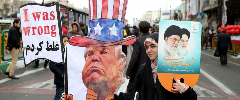FILE - In a Feb. 11, 2019 file photo, an Iranian woman holds an effigy of US president Donald Trump, during a rally marking the 40th anniversary of the 1979 Islamic Revolution, in Tehran, Iran. Iranian President Hassan Rouhani is reportedly set to an