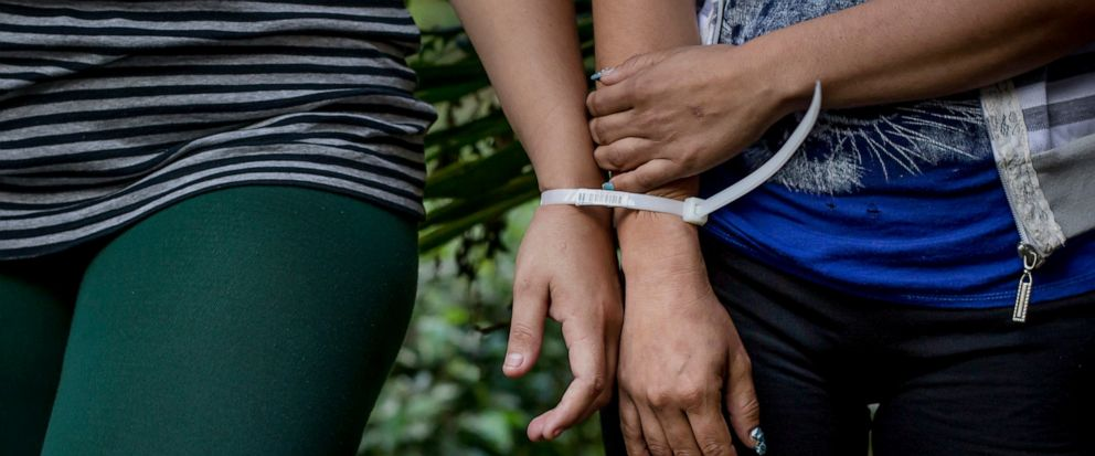 FILE - This Dec. 8, 2016 file photo, shows two women who are accused by police of being part of the Mara Salvatrucha Gang are presented to the media at police headquarters in San Salvador, El Salvador. A court in El Salvador has sentenced on Friday,