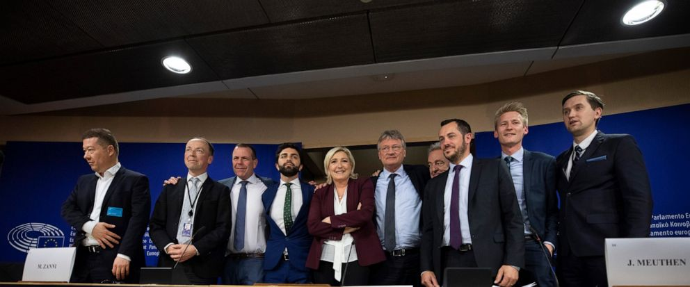 French far-right National Rally leader and MEP Marine Le Pen, center, poses with other far-right members during a media conference to announce the formation of a new far-right European Parliament group at the European Parliament in Brussels, Thursday