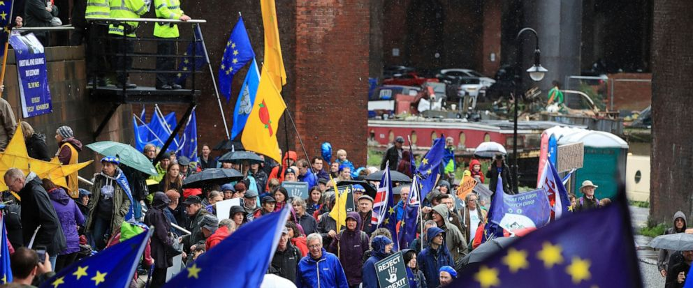 Anti Brexit protesters demonstrate through the streets as part of the Reject Brexit-Defend Our Democracy protest, in Manchester, England, Sunday Sept. 29, 2019. The ruling Conservative Party is committed to Britains Brexit split from the European Un