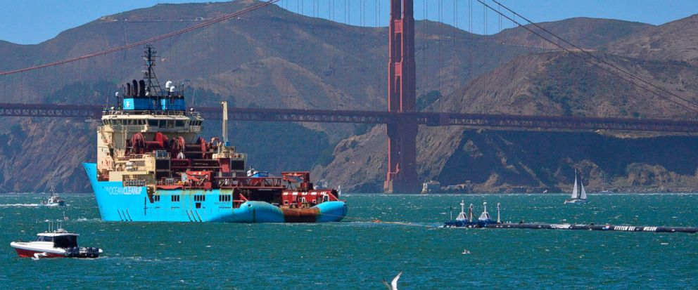 FILE- In this Sept. 8, 2018 file photo, a ship tows The Ocean Cleanups first buoyant trash-collecting device toward the Golden Gate Bridge in San Francisco en route to the Pacific Ocean. A trash collection device deployed to corral plastic litter fl