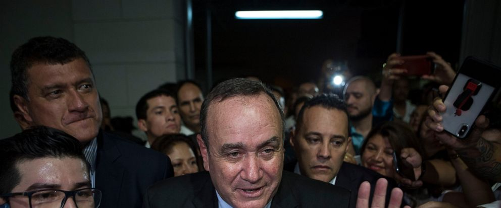 Alejandro Giammatei, presidential candidate of the Vamos party, arrives to the Electoral Supreme Court headquarters for interviews with the press after partial election results were announced in Guatemala City, Sunday, Aug. 11, 2019. Giammattei heade