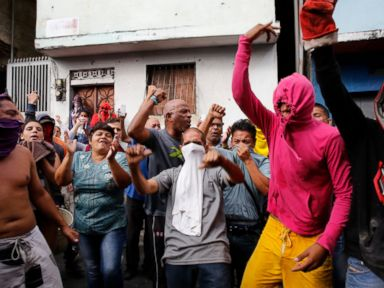Venezuela forces clash with protesters after reported mutiny