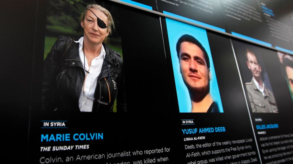 FILE- In this May 13, 2013, file photo, the photo of Journalist Marie Colvin who was killed in Syria while she was reporting from there, is seen on the wall of the Newseum during the Journalist Memorial Re-dedication ceremony of the journalists who died reporting the news in 2012 in Washington. Seven years after Colvin was killed while covering the Syrian revolution, a Washington court has found the Syrian government liable and awarded more than $300 million in damages (AP Photo/Jose Luis Magana, File)