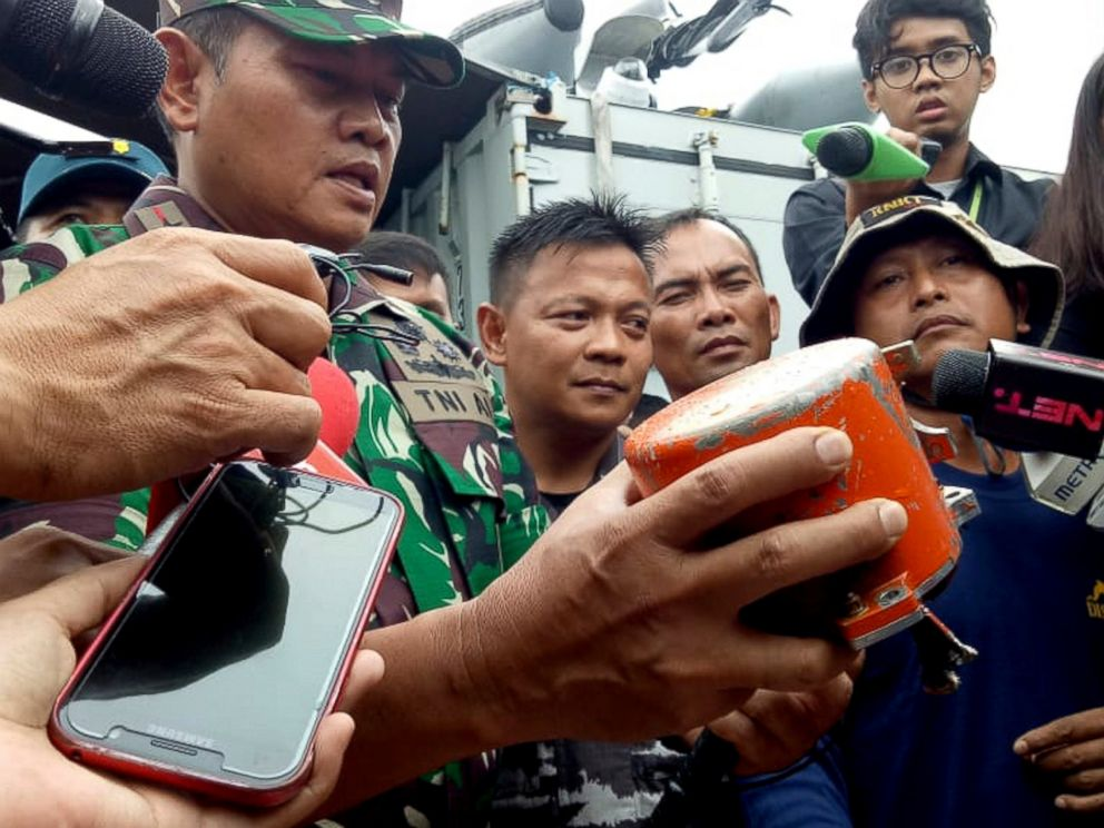 Indonesian Navy Commander Rear Admiral Yudo Margin shows the recovered cockpit voice recorder of Lion Air flight 610 that crashed into the sea in October during a press conference on board of the navy ship KRI Spica in the waters off Tanjung Karawang