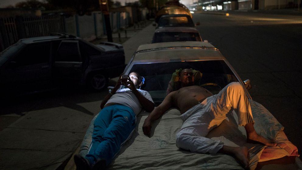 Vast gasoline lines form in oil-rich Venezuela
