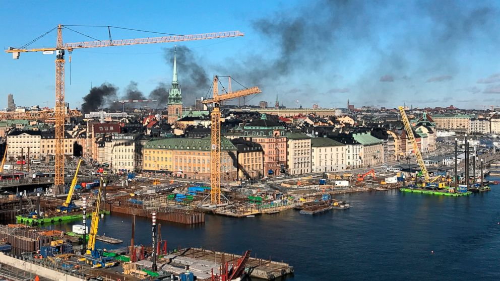 Plumes of black smoke rise into the sky after a bus exploded and caught fire in central Stockholm, Sweden on Sunday March 10, 2019. Swedish media say a natural-gas powered city bus empty of passengers and apparently on a transfer drive has exploded and caught fire in central Stockholm. (Susanne Kivinen/TT via AP)