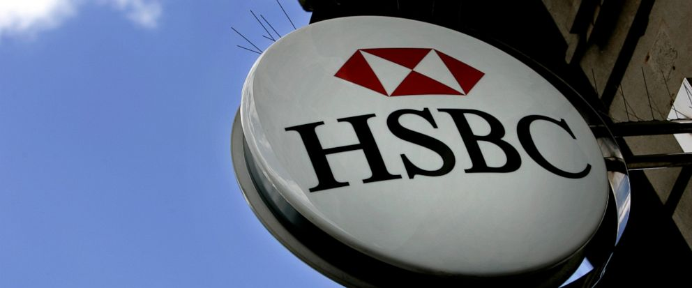 FILE - This July 30, 2007 file photo shows an HSBC sign at a branch in London. British labor union Unite has expressed dismay over reports that the bank HSBC will slash 10,000 jobs worldwide. HSBC declined to comment Monday Oct. 7, 2019 on a Financia