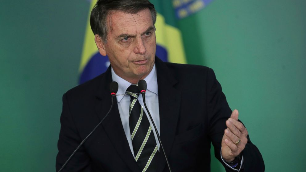 Brazil's President Jair Bolsonaro speaks during a ceremony where he signed a decree loosening restrictions on owning a firearm at Planalto presidential palace in Brasilia, Brazil, Tuesday, Jan. 15, 2019. (AP Photo/Eraldo Peres)
