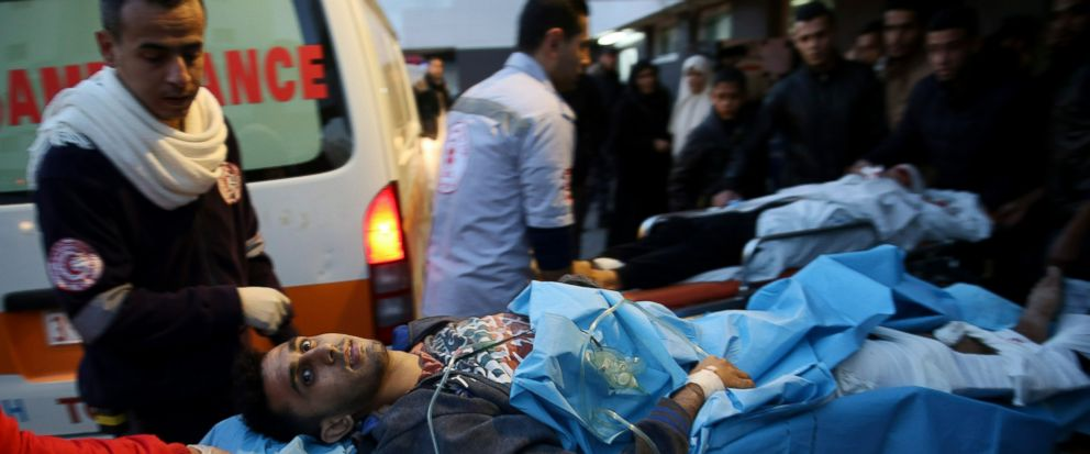 Palestinian medics a wounded youth, who was shot by Israeli troops during a protest at the Gaza Strips border with Israel, into the treatment room of Shifa hospital in Gaza City, Friday, Jan. 11, 2019. (AP Photo/Adel Hana)