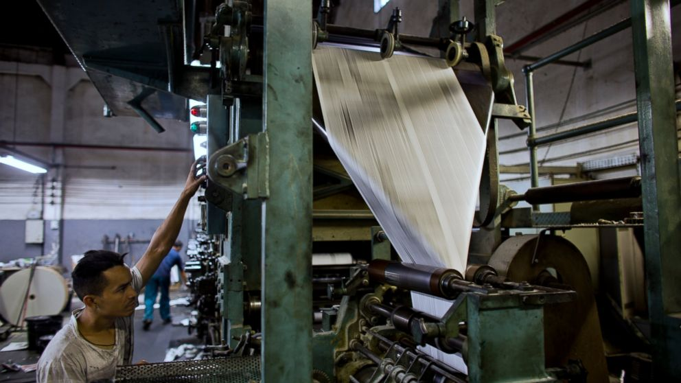 In this Dec. 21, 2018 photo, a worker prints an edition of the Sao Paulo Shimbun Japanese newspaper in Sao Paulo, Brazil. The Sao Paulo Shimbun newspaper printed its final edition on Jan. 1, 2019, ending a 72-year run as a vital reference point and voice for Brazil's Japanese community which is the largest in the world outside of Japan. (AP Photo/Victor R. Caivano)