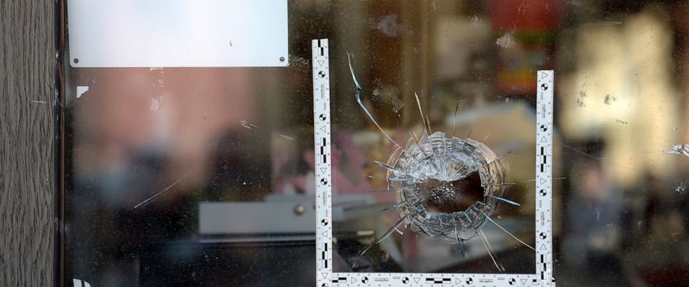 A bullet hole is seen in a window of a kebab grill in Halle, Germany, Thursday, Oct. 10, 2019. A heavily armed assailant ranting about Jews tried to force his way into a synagogue in Germany on Yom Kippur, Judaisms holiest day, then shot two people