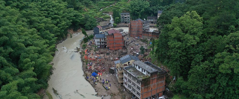 Rescuers search for victims of a landslide triggered by Typhoon Lekima in Yongjia county in eastern Chinas Zhejiang province on Saturday, Aug. 10, 2019. The official Xinhua News Agency says more than 1 million people were evacuated in coastal Zhejia