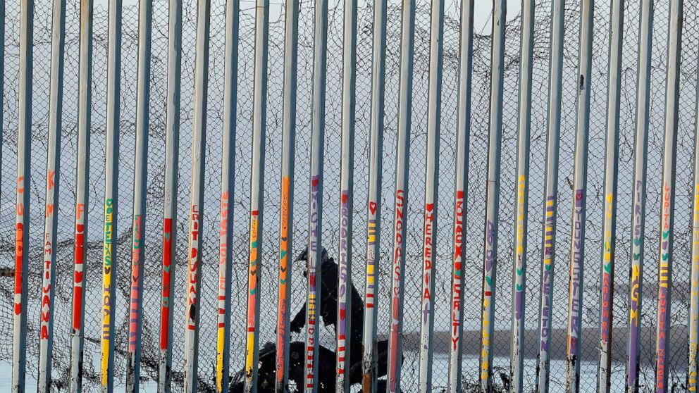 """A U.S. Border Patrol agent rides a vehicle on the beach in San Diego, Wednesday, Jan. 9, 2019, seen through the border wall from Tijuana, Mexico. U.S. President Donald Trump walked out of his negotiating meeting with congressional leaders Wednesday — """"I said bye-bye,"""" he tweeted— as efforts to end the 19-day partial government shutdown fell into deeper disarray over his demand for billions of dollars to build a wall on the U.S.-Mexico border. (AP Photo/Gregory Bull)"""