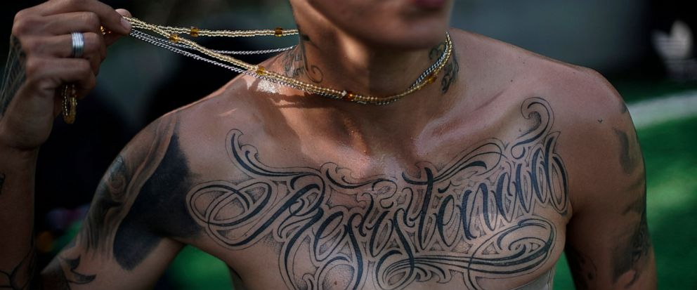 "In this May 13, 2019 photo, transgender Caua Fraga, 23, shows the tattoo on his chest that reads in Portuguese ""Resistance"", before a training session with the Bigtboys transgender mens football team in Rio de Janeiro, Brazil. For the two dozen Bigt"