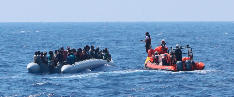 In this photo taken Saturday and released Sunday, Aug. 11, 2019, a rescue team of the Ocean Viking ship, operated by the NGOs Sos Mediterranee and Doctors Without Borders, approaches a rubber dinghy with over 80 migrants off the Libyan coast. The Oce