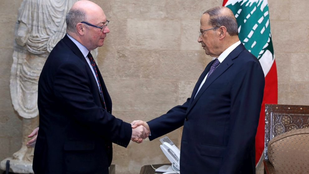 In this photo released by Lebanon's official government photographer, Dalati Nohra, Lebanese President Michel Aoun, right, shakes hands with Britain's Foreign Office Minister Alistair Burt, at the presidential palace, in Beirut, Lebanon, Thursday, March 7, 2019. Aoun spoke up in defense of the country's militant Hezbollah group, telling Burt that the group's allegiances in the region do not affect internal Lebanese politics. (Dalati Nohra via AP)