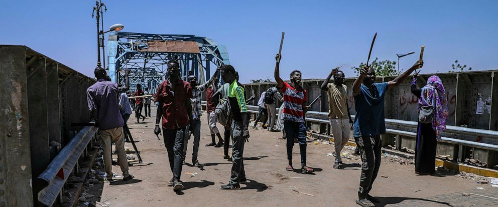 Protesters walk towards the sitin protest outside the Sudanese military headquarters, in Khartoum, Sudan, Tuesday, May 14, 2019. Sudanese protesters say security agents loyal to ousted President Omar al-Bashir attacked their sit-ins overnight, settin