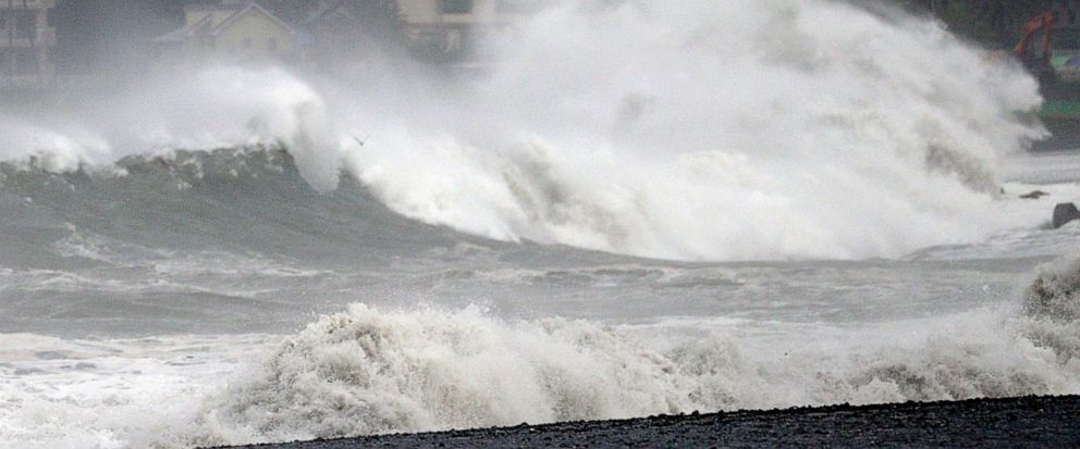 In this Sept. 8, 2019, photo, a high wave hits beach as typhoon approaches in Shizuoka city, central Japan. (Kyodo News via AP)