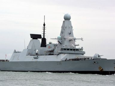 Russia says it may fire to hit intruding warships