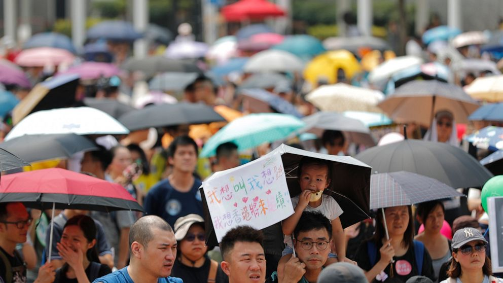 The Latest: Hong Kong police fire tear gas at protesters