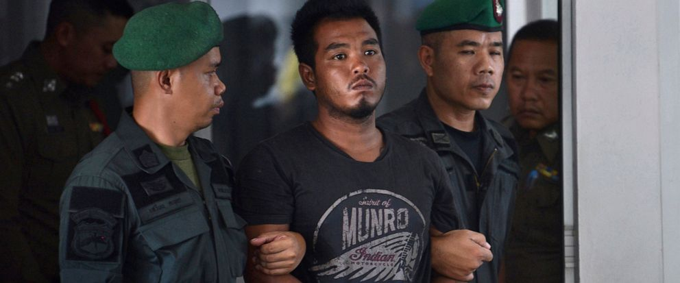 FILE - in this April 9, 2019, file photo, Thai suspect Ronnakorn Romruen, center, is escorted by police as he arrives at the Koh Sichang police station in Chonburi province, Thailand. Ronnakorn was sentenced to death Wednesday, July 10, 2019 by the C