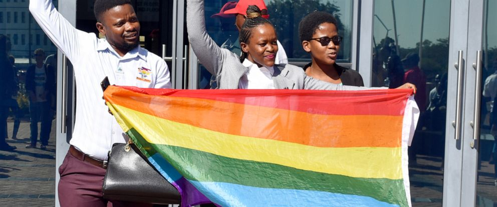 Activists celebrate outside the High Court in Gaborone, Botswana, Tuesday June 11, 2019. Botswana became the latest country to decriminalize gay sex when the High Court rejected as unconstitutional sections of the penal code that punish same-sex rela