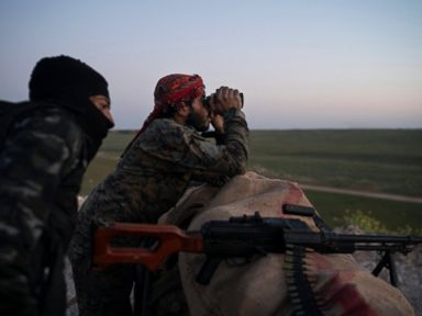 Civilians evacuated from last Islamic State holdout in Syria