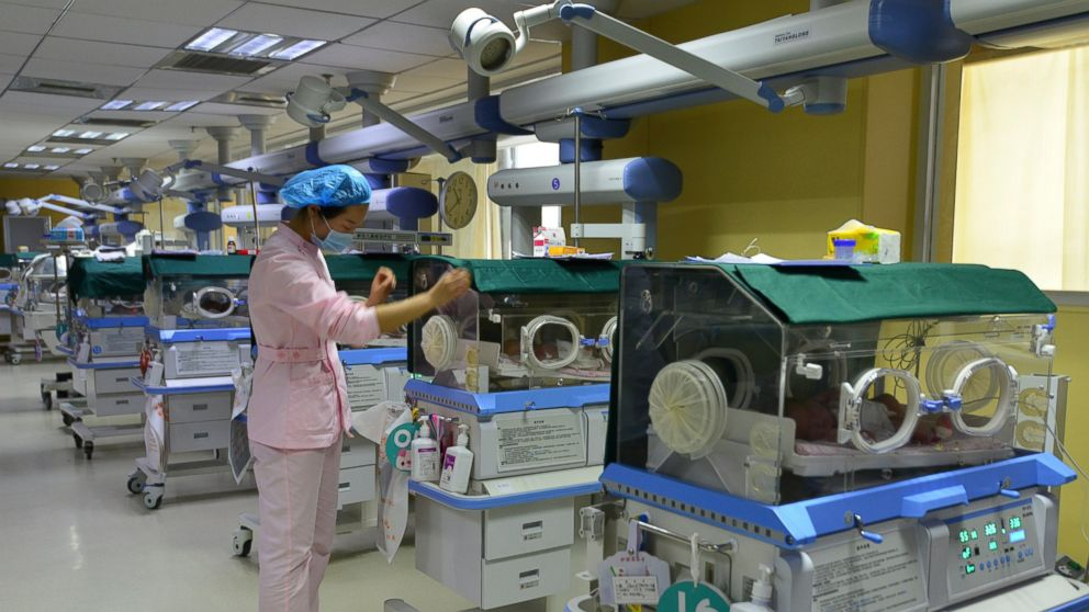 In this Jan. 19, 2019, photo, a nurse checks on the new-born babies under intensive care at a hospital in Fuyang in central China's Anhui province. China's population rose by 15.23 million people in 2018, marking a continued decrease in the growth rate of the world's most populous nation. (Chinatopix via AP)