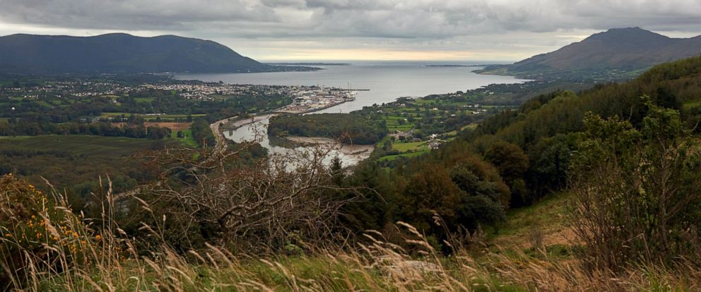 Warrenpoint village in the UK, Northern Ireland nestles on the banks of Carlingford Lough with its ferry that connects Northern Ireland, left of photo, with the Republic of Ireland, right, Wednesday, Sept. 25, 2019. The island of Ireland border issue