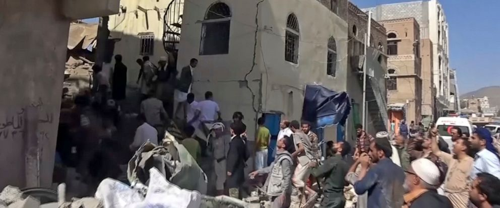 In this frame grab from from video, people search in the rubble following Saudi-led coalition airstrikes that killed at least six, including children, officials said, in the residential center of the capital, Sanaa, Yemen. The Sanaa airstrikes came a