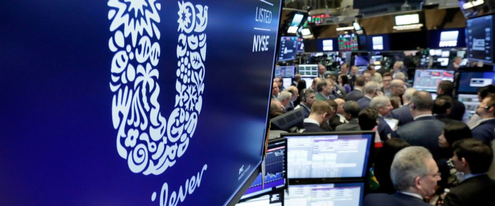 FILE - In this Thursday, March 15, 2018 file photo, the logo for Unilever appears above a trading post on the floor of the New York Stock Exchange. Consumer products giant Unilever, whose brands include Dove soaps and Lipton teas, said on Monday Oct.