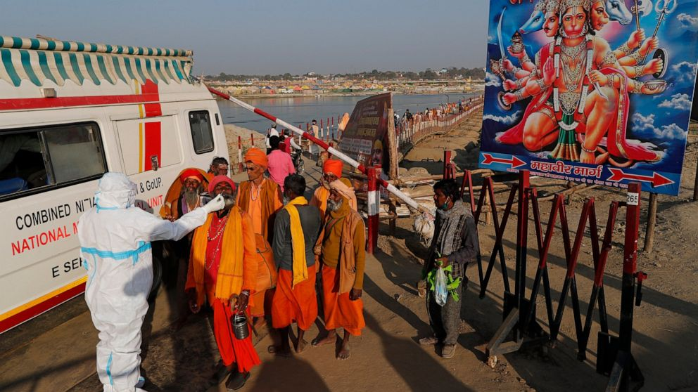 AP PHOTOS: Hindu festival draws crowds of bathers to rivers