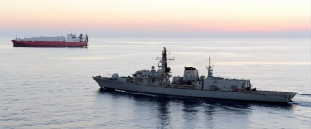 In this image from file video provided by UK Ministry of Defence, British navy vessel HMS Montrose escorts another ship during a mission to remove chemical weapons from Syria at sea off coast of Cyprus in February 2014. The British Navy said it inter