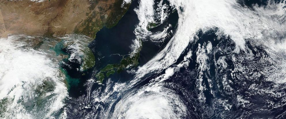 This Oct. 9, 2019, satellite photo taken by NASA-NOAAs Suomi NPP satellite shows typhoon Hagibis approaching Japan, top. Japan's weather agency is warning a powerful typhoon may bring torrential rains to central Japan over the weekend. (NASA Worldvi