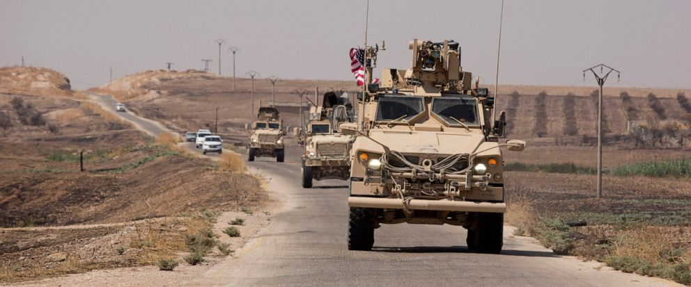 U.S. armored vehicles travel in a joint patrol of the safe zone between Syria and the Turkish border with the Tal Abyad Military Council near Tal Abyad, Syria, Friday, Sept. 6, 2019. (AP Photo/Maya Alleruzzo)