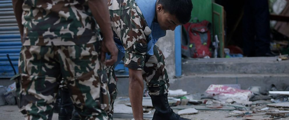 Nepalese army personnel examone the site of an explosion in Kathmandu, Nepal, Sunday, May 26, 2019. Two explosions killed three people and wounded at least five more in different parts of Nepals capital on Sunday, with police suspecting that an outl