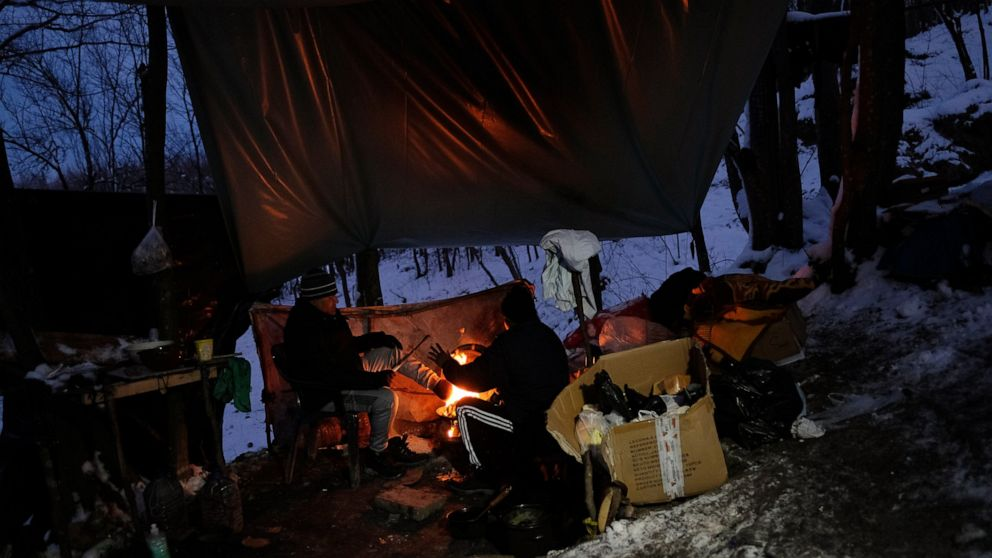 Stuck in Bosnia, migrants sleeping rough face up to winter