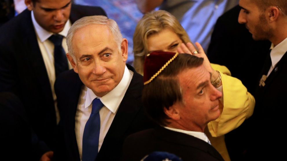Israel's Prime Minister Benjamin Netanyahu and Brazil's President-elect Jair Bolsonaro, exit after a visit to the Kehilat Yaacov synagogue, in Rio de Janeiro, Brazil, Friday, Dec. 28, 2018. According to the Israeli Embassy, Netanyahu will stay in Rio until Tuesday, when he will travel to Brasilia for the presidential inauguration. (Leo Correa/Pool Photo via AP)