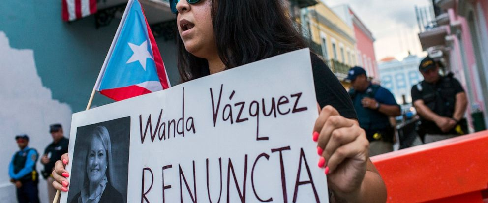Protesters gather outside the government mansion La Fortaleza in San Juan, Puerto Rico, Wednesday, Aug. 7, 2019, calling for the removal of the islands newly sworn-in governor. Justice Secretary Wanda Vazquez took the oath of office early Wednesday